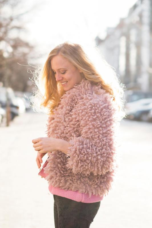 A fuzzy pink jacket and sweater - The Golden Bun