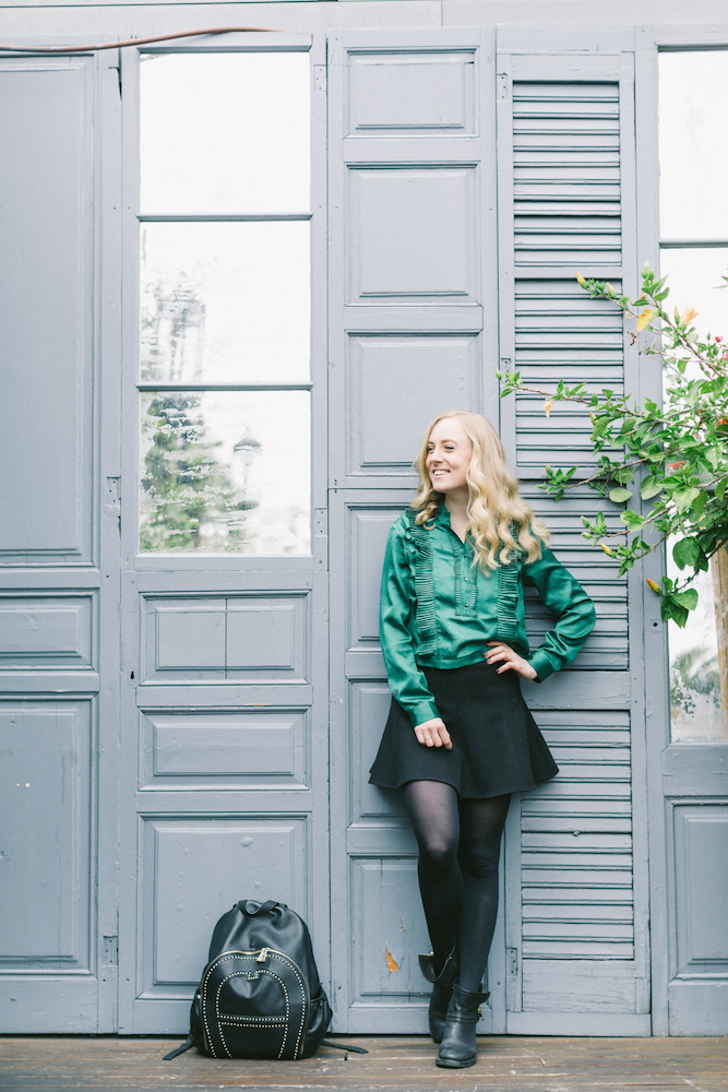 H&M Trend blouse, Barcelona shooting En route photography H&M Trend green ruffle blouse Aigner backpack Swarovski delicate ring