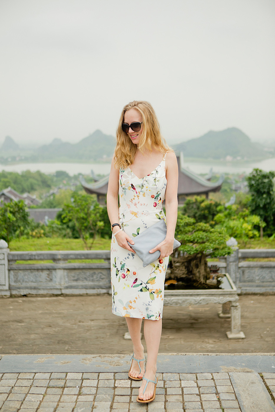 www.thegoldenbun.com | oasis floral dress, traveling outfit
