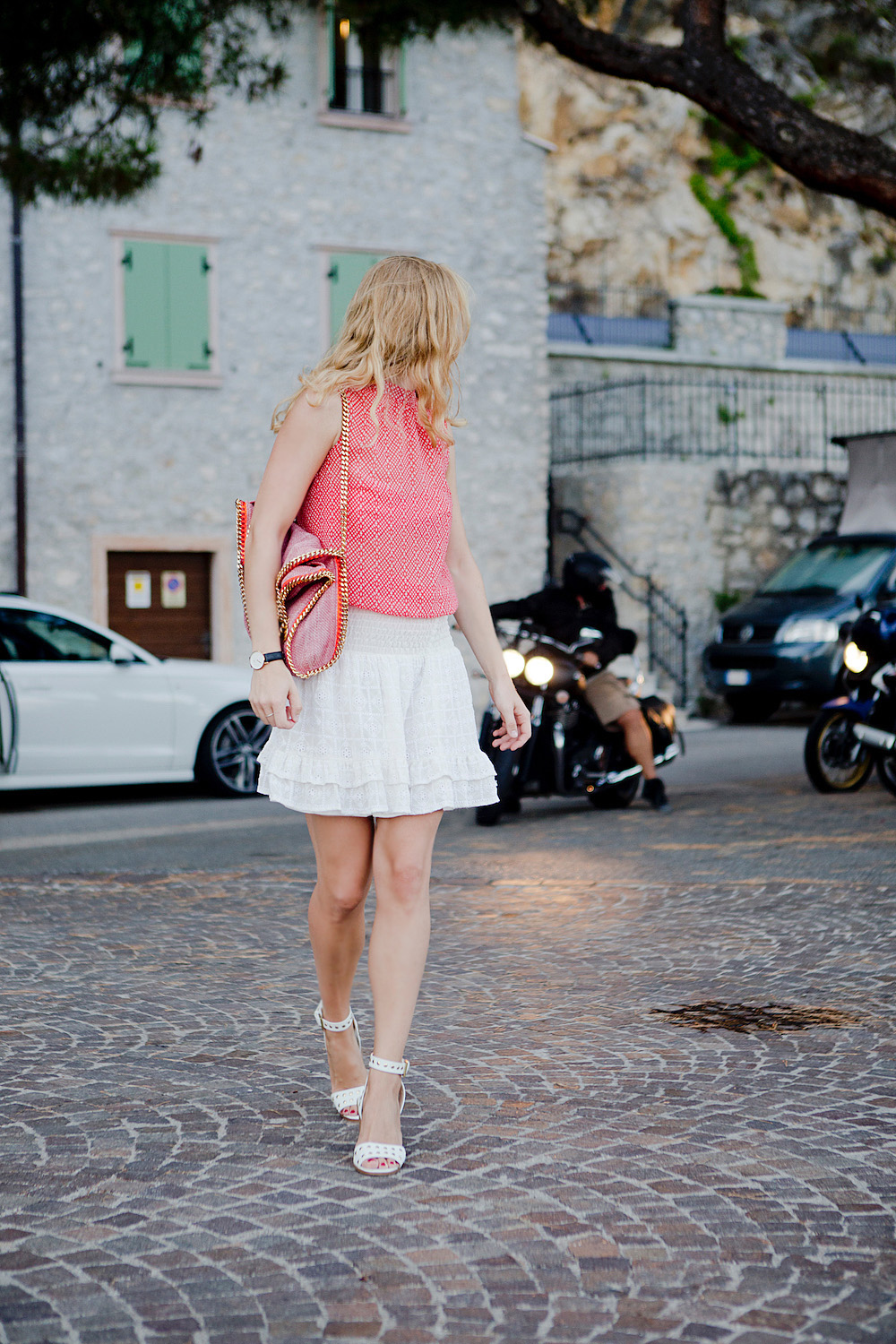 summer look with white skirt white sandals stella mccartney falabella