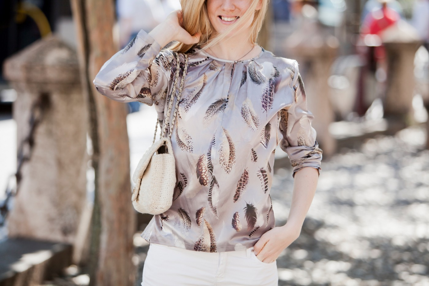 A feather print silk blouse from Jacques Britt & white pants