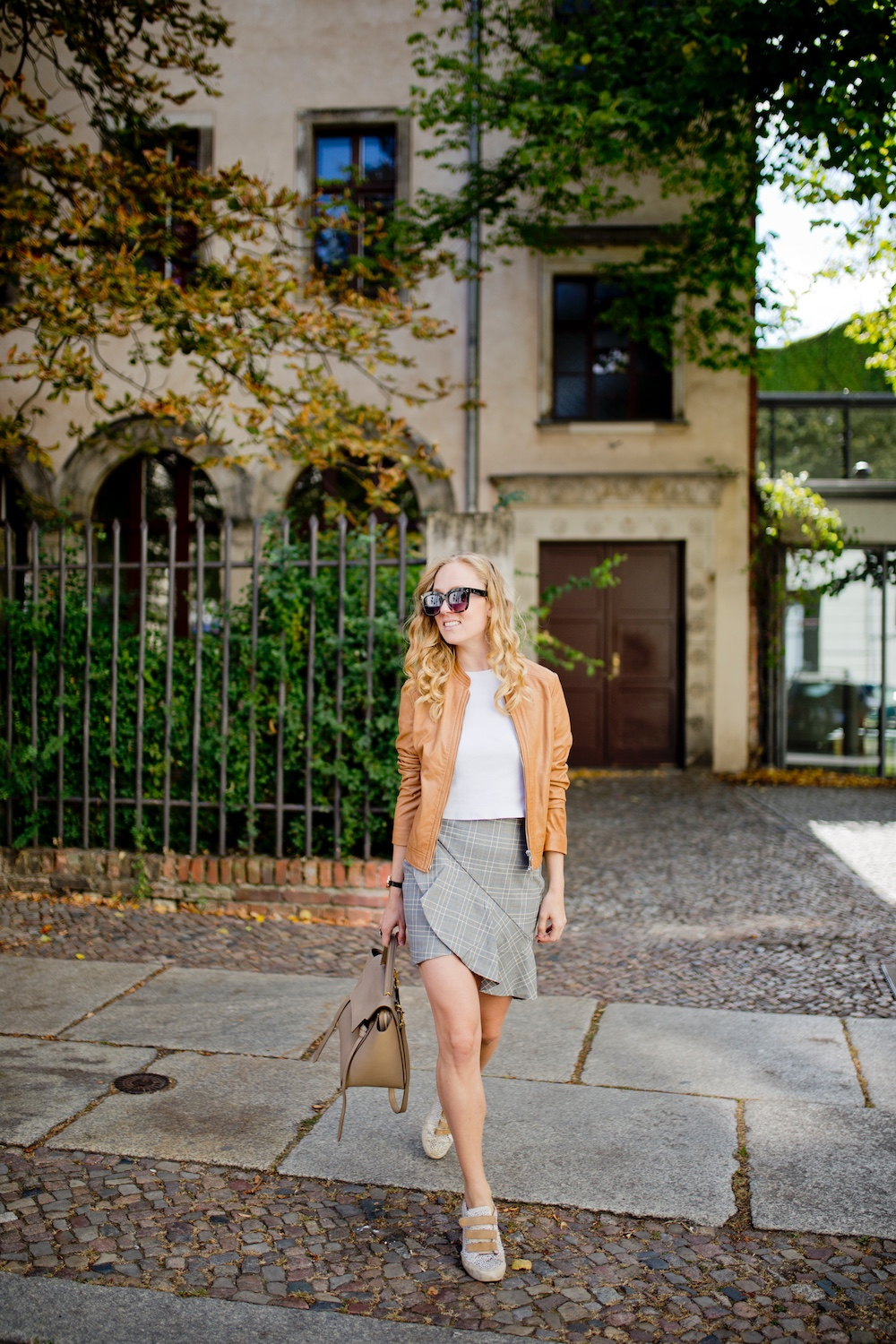 ochre leather jacket grey check skirt